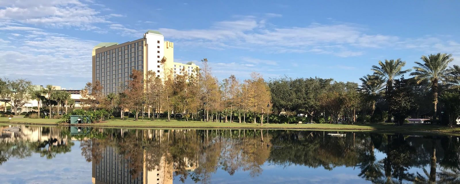Shot of Rosen Plaza from the other side of lake with reflection in water