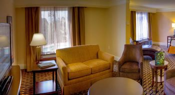 Junior Suites Couch, TV, and Tables
